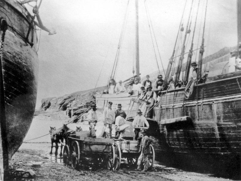 Women loading the slate on Port Gaverne beach c1870