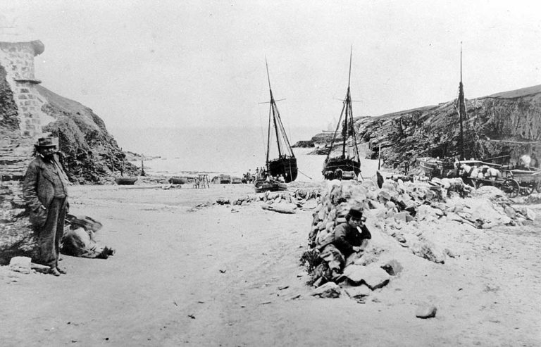 Three ships abreast in the cove c1870. The gentleman on the left is Warwick Richard Guy who owned much of Port Gaverne. Note the loaders' children sitting on the floor by him, peeping round at the camera